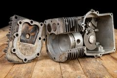A four-stroke gasoline engine in section. The interior of a single-cylinder internal combustion engine. Dark background stock photo