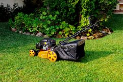 Four stroke petrol lawnmower. 139cc overhead valve 4 stroke petrol lawnmower, Calahonda, Mijas Costa, Costa del Sol, Andalusia, Spain, Western Europe Royalty Free Stock Image