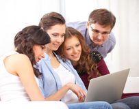 Four students and a laptop Stock Photography