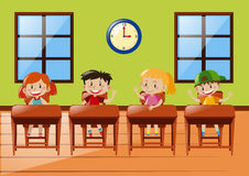 Four students sitting in classroom Royalty Free Stock Images