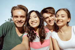 Four students smiling warmly Stock Image