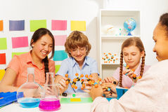 Four students studying chemistry at the classroom Royalty Free Stock Image