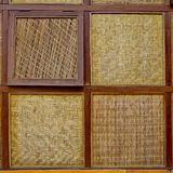 Four Styless of bamboo woven windows with wooden edge background Royalty Free Stock Photography