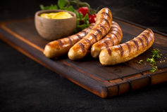 Four succulent grilled pork sausages royalty free stock photos