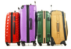 Four suitcases on white background Stock Photo