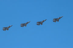 Four supersonic interceptor aircrafts in flight Royalty Free Stock Images
