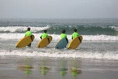 Four surfers Royalty Free Stock Images