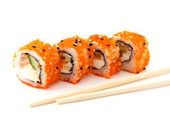 Four sushi roll and chopsticks on white Royalty Free Stock Image