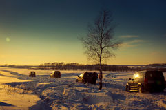 Four SUV on a winter sunset Stock Image