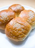 Four sweet buns with sesame seed Royalty Free Stock Photos