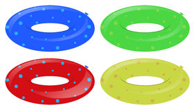 Four swim rings in different colors. Illustration Stock Photo