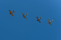 Four T-6 Texan Airplane Fly Overhead Stock Photos