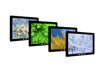 Four tablet computers with images of seasons Stock Photo
