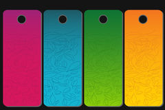 Four tags. In different colors with floral design Stock Images