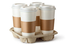 Four take-out coffee in holder. Standing on a white Stock Images