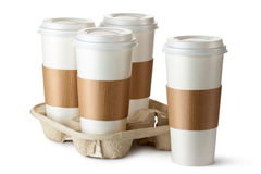 Four take-out coffee. Three cups in holder. Standing on a white Royalty Free Stock Photography