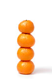Four tangerines in the form of a column Royalty Free Stock Images