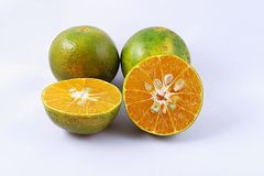 Tangerine [Thonburi]. The four tangerines split in a half on white background Stock Photos