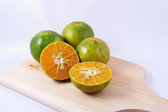 Tangerine [Thonburi]. The four tangerines split in a half on white background Royalty Free Stock Photos