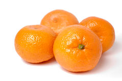 Four tangerines on white. Four tangerines isolated on white Stock Images