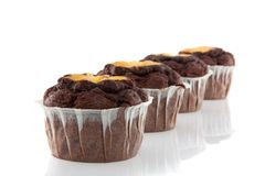 Four tasteful chocolate muffins Royalty Free Stock Photography