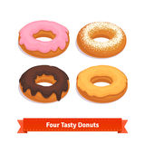 Four tasty flavoured donuts with glazing Royalty Free Stock Images