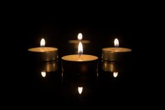 Four Tea Candles with Reflection on Black Royalty Free Stock Photo