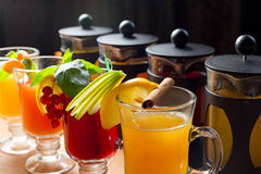 Four teapots and glasses Royalty Free Stock Photos