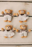 Four teddy bears on wooden background Royalty Free Stock Photos