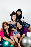 Four teen girls cheer together Stock Images