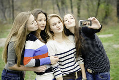 Four teen girls taking picture of themselves Royalty Free Stock Photos
