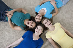 Four teenage girls having fun with girlfriends at  Stock Image