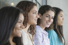 Four teenage girls in a row. Stock Image
