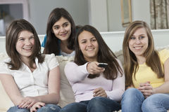 Four teenage girls watching television Stock Image