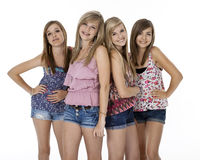 Four Teenage Girls on White. Four teenage girls in summer clothes standing, isolated on white Stock Photography