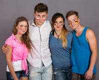 Four teenagers with flags drawn on the faces royalty free stock photo