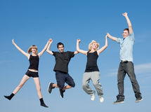 Four teenagers jumping. On background of sky Stock Images