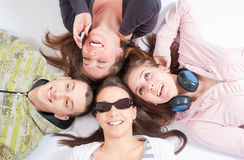 Four teenagers lying on white Stock Image