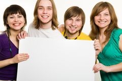 Four teenagers with a poster in front Stock Image
