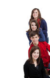 Four teenagers smiling on a white background. With copy space Royalty Free Stock Photos