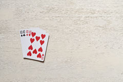Four ten playing cards on light desk. Royalty Free Stock Images