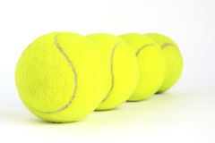 Four tennis ball. On a white background Stock Photo