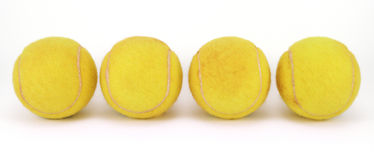 Four tennis balls stock photos