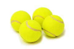 Four tennis balls isolated. On the white Royalty Free Stock Image