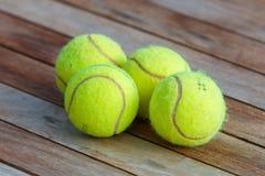 Four tennis balls stock photography