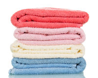 Four of terry towels different colors isolated on white. Stock Photos