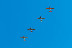 Four AT-6 Texan Airplanes Fly Overhead Stock Photo