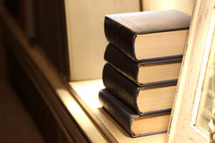 Four thick books lying on the shelf Royalty Free Stock Image