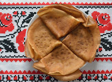 Four thin pancakes on the towel Royalty Free Stock Photography