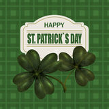 Four and three leaf clover. Greeting inscription St. Patrick Dn. Isolated on the background. Of green cells. Vector illustration Royalty Free Stock Image